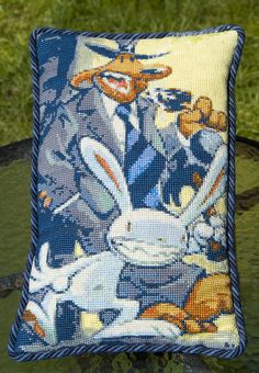 Cross stitch Sam & Max pillow by me, via Flickr