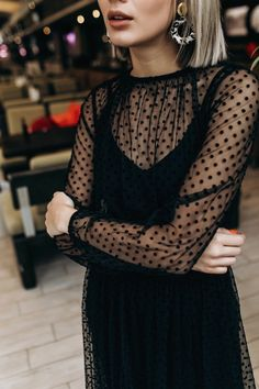 Black dress with sheer lace polka dotted detailing over the neck and sleeves. // Fun twist on the classic little black dress. // Paired with funky hoop earrings and nude lip. Black Women Fashion, Womens Fashion, Fashion 2018, Fashion Fashion, Looks Chic, Inspiration Mode, Looks Vintage, Spring Trends, Sheer Dress