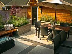 Tiny backyard oasis with fire feature, dining room, raised gardens, built-in bench, and cabana/garage Raised Gardens, Built In Bench, Cabana, Oasis, Garage, Dining Room, Backyard, Fire, Building