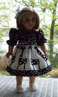 Fits American Girl doll or 18 inch doll. Doll dress and hair clip from novelty giraffe print with black and white dot trim..