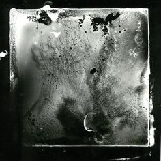 Dark room print created by placing a sample of my blood onto a microscope slide and placing it into the enlarger.
