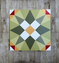 Barn quilt in four shades of green, yellow, red and white. This barn quilt would not only look beautiful on a barn but also on your garage or shed! Wood is exterior grade MDO plywood for a smooth finish. Paint is exterior paint suited for outdoor use. Can be made to order in your colors. Please allow 1 - 2 weeks. Size is 2 x 2.