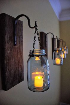 Mason Jar Candle Sconces made from Reclaimed barn wood. Mason Jar Candle Sconces made from Reclaimed barn wood.