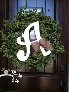 Monogram Wreath: a store bought wreath, a painted and distressed letter and a pretty burlap bow. During the holidays simply change out the wreath and bow and have a different look.