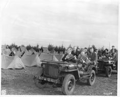 President Franklin D. Roosevelt inspects troops from a Jeep Willys MB at Camp Anfa, Casablanca. Circa 1/18/1943. Courtesy of National Archives and Records Administration.