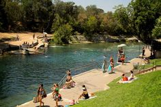Jump into the giant year-round 70-degree spring-fed heart of the city, Barton Springs Pool. | 35 Things Everyone Should Do In Austin, Texas, Before They Die