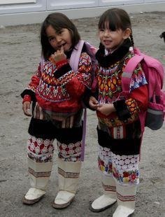 Greenland has a national costume—traditional Inuit animal skin garb transformed with Danish textiles and beads—and the people wear it proudly on special days. These special days include the first day of kindergarten. Cultures Du Monde, World Cultures, We Are The World, People Around The World, Beautiful Children, Beautiful People, Adorable Petite Fille, Ethnic Dress, Folk Costume
