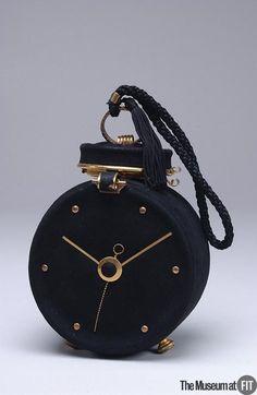 black suede brass evening bag - lederer - france - 1950s purse shapedlike a clock or pocket watch.