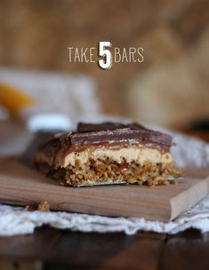 Take 5 Bars | Cookies and Cups A pretzel crust, topped with peanut butter filling, homemade caramel, Honey Roasted Peanuts and a milk chocolate topping.  Seriously good!
