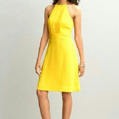 Banana Republic Yellow Halter Dress Beautiful ribbon details on the front. Yellow Halter Dress is fully lined. The shell and lining are 100% poly. Dress ties at back of the neck.  Excellent new condition Banana Republic Dresses