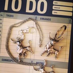 Necklace, keychain, handbag charm, in heritage silver. Necklace has 18 inch chain. Both bull and chain have antiquing effects. Handbag charm has a fairly small lobster clasp (32mm), so be sure your handbag has relatively small hardware if you want to attach the charm.