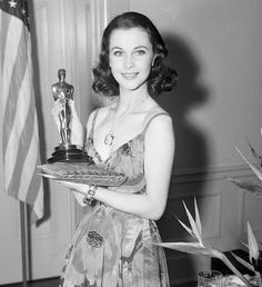 Vivien Leigh For the 1940 Oscars, Leigh ditched the corsets and hoop skirts her Gone With the Wind character Scarlett O'Hara wore in the iconic film and instead wore this spaghetti strap dress by Irene Gibbons, featuring a lively poppy print and cut-outs at the waist.