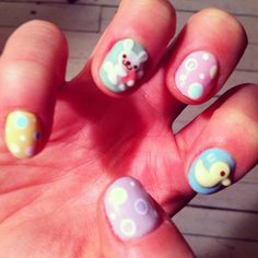 Fun 3D nail art for Easter. Pastel nails with baby duck and white bunny.