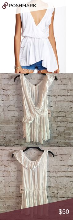 "Free People Float Away Tank White Ivory Faux Wrap Free People Float Away Tank in Ivory. Very feminine faux wrap sleeveless tank top. Approximately 27"" Long. 100% Rayon. Hand Wash and lay flat to dry. Size XS from Free People. NWT 50828170 Free People Tops"