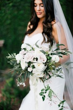 Hand-tied bridal bouquet with blush pink roses, green leaves, jasmine, and ivy |Feather& Twine Photography | villasiena.cc