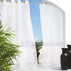 Sheer indoor/outdoor curtain panel with a grommet top.Product: Curtain panelConstruction Material: 100% Polyester and steelColor: WhiteFeatures: Mildew resistant  Water repellent  UV resistant Eight stainless steel plated rust resistant grommets Suitable for indoor and outdoor use Cleaning and Care: Machine wash cold. Do not use chlorine bleach. Line dry.
