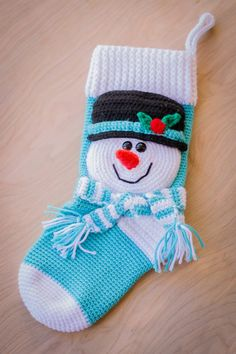 Stocking pattern by Mary Smith The Snowman Stocking is an exclusive design inside Issue (July of Happily Hooked Magazine!The Snowman Stocking is an exclusive design inside Issue (July of Happily Hooked Magazine! Crochet Christmas Stocking Pattern, Crochet Stocking, Crochet Snowman, Crochet Christmas Decorations, Crochet Amigurumi, Holiday Crochet, Christmas Knitting, Crochet Baby, Crochet Christmas Stockings