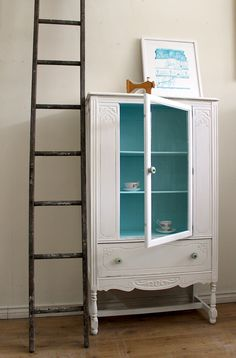 for the kitchen, staff lounge area. White Hutch/China Cabinet. $575.00, via Etsy.