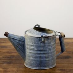 galvanized watering can: Galvanized water-proof watering can with handle. 3.00 each. Put a bunch of baby's breath in it. For front of ceremony and moved to reception area