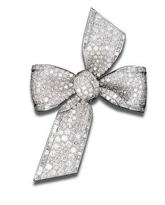 Diamond bow brooch by Tiffany and Co., pavé-set with baguette-cut diamond trim, mounted in platinum, circa 1955 Diamond Brooch, Silver Brooch, Silver Ring, Diamond Jewellery, Silver Earrings, Earrings Uk, Bow Jewelry, I Love Jewelry, Wedding Jewelry