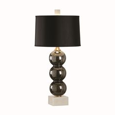 """The Cumulus Lamp features three black speckled mercury glass vertically stacked on a white marble mounting. Grosgrain fabric covers the drum shade, while brass accents lend a glam touch. 35"""" H"""