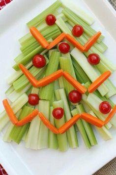 Xmas tree made with celery, carrots and cherry tomatoes... could vary by adding broccoli to the tree.