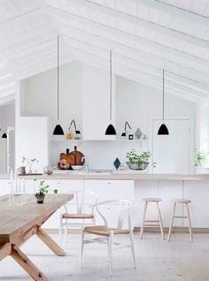 Best Bright white kitchen with lightwood floors countertops table stools white wishbone chairs