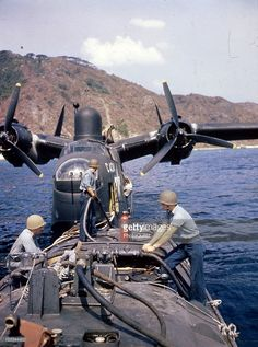 A Martin PBM-5 Mariner patrol bomber, of Fleet Air Wing One refuels from a fuel bowser boat in Tanapag Harbor, Saipan, May 1945. Note the plane's radar antenna atop the fuselage and loaded .50 cal machineguns in her bow turret.