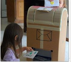 Cardboard Mailbox...Postcards from students to Santa, military...