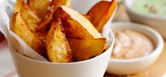 Home-made paprika potato wedges with a trio of dips