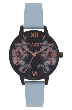 A muted leather strap brings striking contrast to this matte-black watch with polished rosy hour markers and hands accenting a dial of romantic midnight blossoms.
