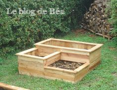 Square garden planter with three bins made from recycled wooden pallets.