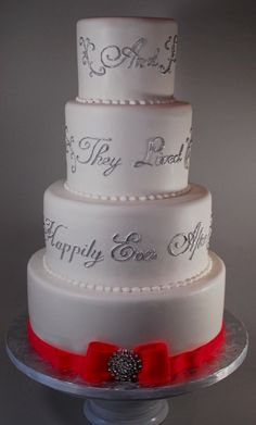 """And They Lived Happily Ever After"" wedding cake but with a yellow or navy blue ribbon and bow on the bottom."