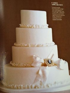 Cake with ruffles and cameo. (Southern Living Weddings 2012)