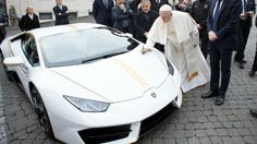 Pope Francis' Lamborghini (he should of given it a spin before donating to charity...)