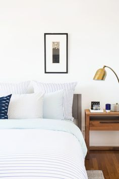 """Styling the nightstands was a delicate balance between looking too sterile and being too crowded. I ended up keeping it pretty simple by using a tray from <a href=""""http://lawsonfenning.com """" target=""""_blank"""">Lawson-Fenning</a> to corral everything and a small sculpture by <a href=""""http://benmedansky.com/#intro"""" target=""""_blank"""">Ben Medansky</a> to add visual interest."""