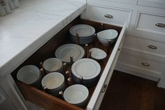 large drawer with separators for plates and bowls.  I am a huge lover of large drawers - so much easier than cabinets in my opinion.