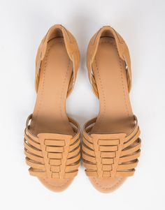 Slip into comfort with these Woven Open Toe Flats. Comes in a black or tan color of your choice. Made from a faux leather fabric. Features a peep toe opening, huarache woven detail, and slightly padde