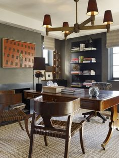 "cool ""manly"" office- like the charcoal green gray walls"