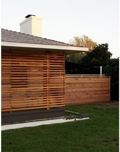 I saw a lot of slat fences in Austin - really like the look