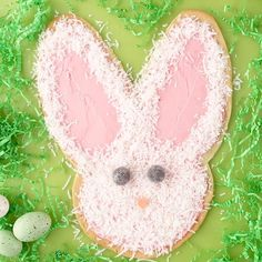 This adorable Giant Bunny Cookie is perfect for your Easter dessert table. We used pre-made cookie dough and strawberry frosting to make this Easter treat even easier. For more holiday fun, shape the cookie dough in a big bell for Christmas, a giant pumpkin for Halloween, or a huge heart for Valentine's Day. #easterrecipes #easterdessert #easterfood #cookiecake #giantbunnycookie #bhg