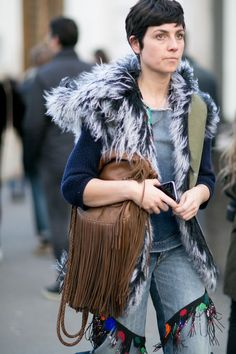 fur and fringe... #EvaFontanelli being her gorgeous self in Paris. hollywoodclosetrentals.com