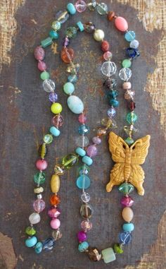 Colorful knotted butterfly necklace Spring Fever von slashKnots