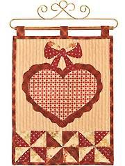 Vintage Blessings February Wall Hanging Quilt Pattern from Annie's Craft Store. Order here: https://www.anniescatalog.com/detail.html?prod_id=127468&cat_id=1430
