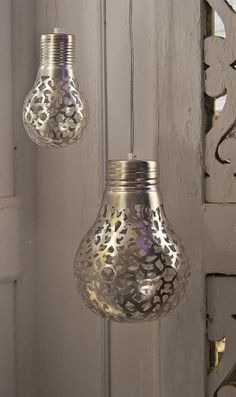 Spray paint a bulb covered with lace. Remove the lace and ... tah-dah, pretty. (DIY tutorial recommend high heat BBQ paint, silver perm. pens, or use lights for decoration only)