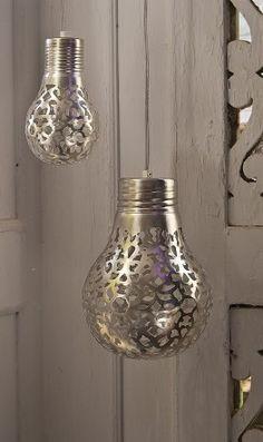 Spray paint through lace on bulbs.