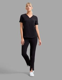 Relaxed Cuff Sleeve Top in Black is a contemporary addition to women's medical scrub outfits. Shop Jaanuu for scrubs, lab coats and other medical apparel. Scrubs Outfit, Lab Coats, Medical Scrubs, Scrub Tops, Cuff Sleeves, Normcore, Uniform Ideas, Comfy Clothes, Black