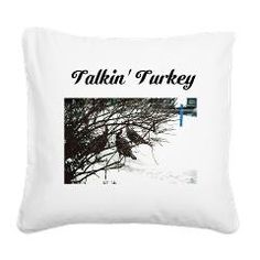 """""""Talkin' Turkey"""" canvas, square throww pillow with original photo of wild turkeys chatting in the snow. Probably wondering where's spring or sharing stories about their great escape from the Thanksgiving table. A definite conversation piece. Pillow retails for $23.99."""