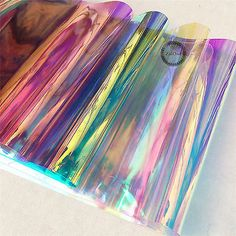 Details about Transparent Clear Holographic Iridescent PVC Fabric Mirror Film Vinyl Bag Craft PVC Holographic Clear Film Mirrored Foil Holographic Vinyl Graphic Fabric This is a Holographic PVC fabric, which can reflects a variety of color. Pvc Fabric, Vinyl Fabric, Pvc Vinyl, Fabric Crafts, Fabric Shop, Vinyl Crafts, Diy And Crafts, Quick Crafts, Holographic Fabric