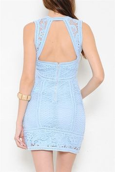A dress featuring a crochet overlay. V-neckline. Sleeveless. Cutout back with zipper closure. Fully lined. Finished hem.